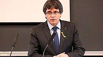 Puigdemont cede